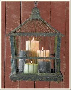 Candles in an Old bird cage...Love it!!! bathroom windows.  Two different shapes, similar sizes