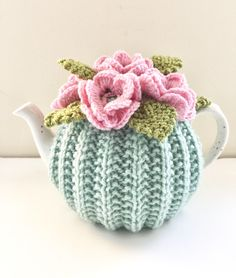 Hand-knitted tea cosy to keep your tea hot in style. https://www.etsy.com/uk/listing/229617970/hand-knitted-floral-tea-cosy-in-pure