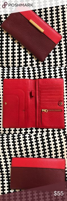 Marc by Marc Jacobs travel wallet MARC by Marc Jacobs 'hail to the queen' travel wallet in two-tone Cabernet red. Richly textured leather and sophisticated finish elevate a slim travel wallet accented with gold logo engraved hardware. Lightly used, please see photos. 8.5in long, 5.5 width. ✨No trades, will consider all reasonable offers ✨ thanks for looking❗️ Marc by Marc Jacobs Bags Wallets