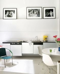 Minimalist kitchen. Ok, it's the chairs...Eames FTW!