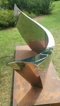 Mirror polished stainless steel sculpture entitled voyage. ..