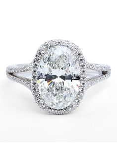 'Oval Elegance' from Forevermark  -  Similar to what Josh Murry gave Andi Dorfman on Monday, July 28, 14, 'The Bachelorette'.  Andi's engagement ring has a 3 ct oval center stone w/two rows of round stones circling center stone & one row rounds going partway down the shank.  -  Blog.TheKnot.com   (07.29.14)