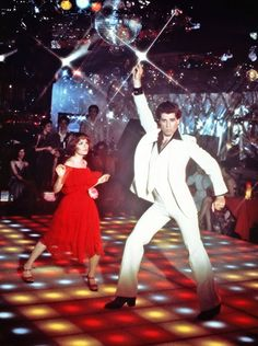 "December 16, 1977 – John Badem's ""Saturday Night Fever"" opened wide on this day. John Travolta earned an Academy Award nomination for his leading role as Tony Manero, a streetwise New Yorker who reigned supreme in white polyester while gliding across a Technicolor dance floor. Not only did the film propel Travolta to movie stardom, it ignited a world-wide disco fever which still burns today."