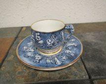 vintage R. CAPODIMONTE TEA CUP and Saucer set : raised figures and face on handle , made in Italy