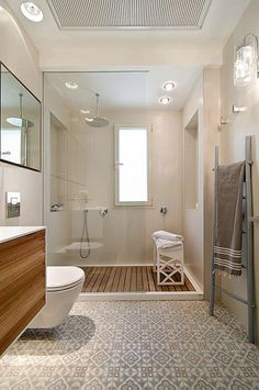 Bathroom with a floating vanity, wood planks in the shower, and a patterned tile!