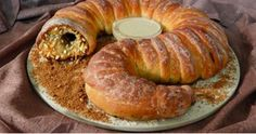 "This is one of the best holiday bread/cake recipes I've ever seen! A spiced-filled Dune sandworm!   Now, I haven't made this sucker yet—so I don't know what it tastes like—but I fully intend to test my culinary skills this weekend and try this worm out.   I don't know how many people would watch David Lynch's take on Dune and see something yummy when the grotesque sandworms are onscreen, but Chris-Rachael Oseland over at The Kitchen Overlord came up with this brilliant-looking recipe. ""Th..."