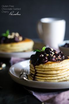 Chocolate Swirled Gluten Free Pancakes with Cherry Sauce and Hazelnuts – Ooey, gooey and so decadent! These pancakes are SO easy and perfect for Mother's Day or brunch! | Foodfaithfitness.com | @FoodFaithFit