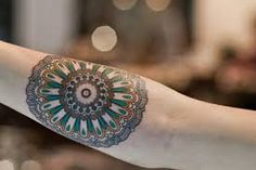 Resultado de imagen de mandala tattoo hombre