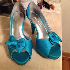Malibu blue heels Malibu blue • 6.5 US • open inside of heel • worn maybe 3 times • satin • can be redyed at local bridal shop  Shoes Heels