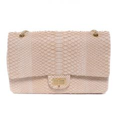 This is an authentic CHANEL Python 2. 55 Reissue 227 Flap.