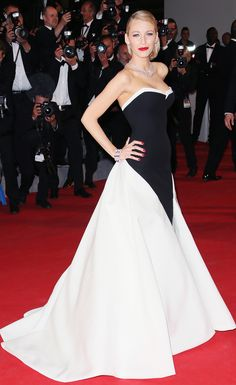 Blake Lively stuns in a Gucci Premiere black and white silk fifties-inspired gown and Lorraine Schwartz diamond studs, necklaces, and pearl, ruby, & diamond bracelet on the #redcarpet at #Cannes2014. #BlakeLively