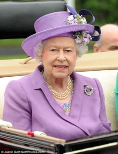 Ascot Day 3, 2013...The Queen was predicted to wear blue on Ladies Day, but instead she chose a pale lavender summer coat on top of a floral dress, with a diamond brooch and matching lavender hat with pretty summer flower embellishment.