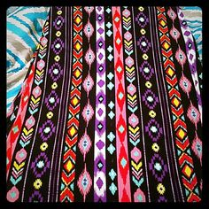 Stretchy Tribal Maxi Skirt It is a floor length, stretchy, multi colored Maxi Skirt. It is extremely comfortable and flowy. NWOT but never worn, except when I tried it on in the store. Rue 21 Skirts Maxi
