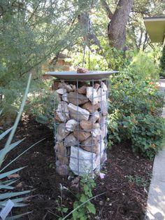 Imagine using a similar DIY birdbath framework as a small trellis for climbing plants. =)