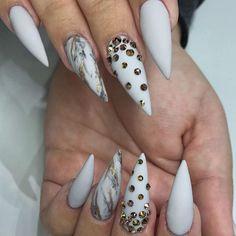 Stilleto nails with rhinestones.