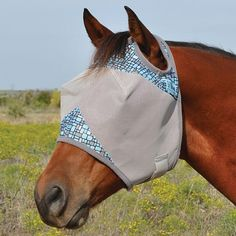 Cashel Crusader Patterned Standard Fly Mask, available in Black Flare, White Flare, or Teal Geo - 3-hole cap eliminates forelock damage and ensures comfort with its unique design that stays put. Mesh blocks 70% of the sun's damaging UV rays and protects the sensitive tissues.