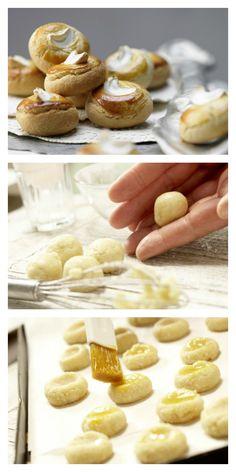 Vor dem Backen werden die Bethmännchen mit Eigelb bestrichen und mit Cashewkernen geschmückt: Cashew-Bethmännchen mit Marzipan |http://eatsmarter.de/rezepte/cashew-bethmaennchen