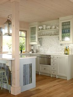 Sarah Richardson--kitchen with distressed wood side panels on some cabinets.