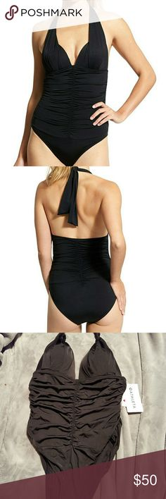 Athleta Aqualux Halter One Piece This NWT black one piece from Athleta is truly a beautiful suit. It is from the aqualux collection that makes it feel luxurious when on. It has wireless support with molded cups from the perfect support and coverage. It has shirring along the cups and backside for a flattering fit. It also has knotted details on the halter ties. This piece is sure to make you feel sexy, while keeping you covered. Athleta Swim One Pieces