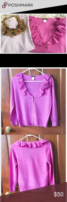 🎀JCrew Cascading Ruffled Rose Cardigan 🎀 🎀JCrew Cascading Ruffled Rose Corsage Cardigan Sweater! Presented in a luxurious pink raspberry fine gauge merino wool, this v-neck cardigan has the most luscious ruffle that lines around the neckline. There are two perfectly placed roses to one side that make a corsage, it's just the most beautiful way to brighten a dreary fall/winter day! Button front, long sleeves. 🎀The t-shirt pictured is also available in a separate listing! 🎀 J. Crew…