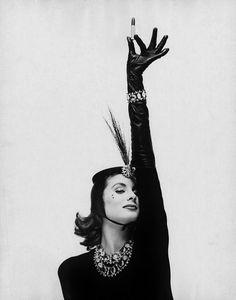 Suzy Parker holding a lipstick aloft. Photographed by Dan Wynn.