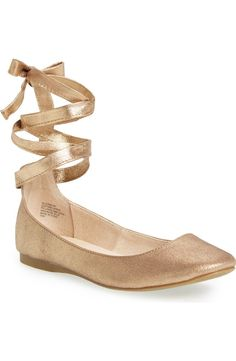 In love with these ballet-inspired flats in gold with wraparound laces. They will pair perfect with dresses and skirts.