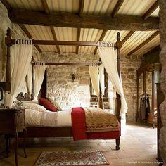 romantic bedroom....love the interior stone