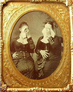 Victorians often had portraits taken during times of mourning with their faces covered or veiled, or with their backs to the camera. Strange custom...