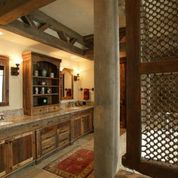 Rustic bathroom retreat with custom woodworking and cabinetry.