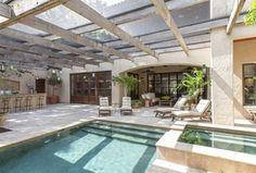 Mediterranean Patio with Glass panel door, Outdoor kitchen, Skylight, exterior stone floors