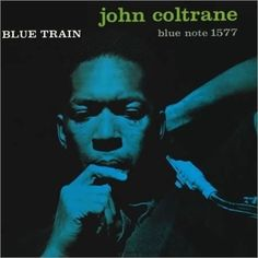 John Coltrane's Blue Train on Blue Note Records. John Coltrane tenor saxophone; Paul Chambers — double bass; Kenny Drew — piano; Curtis Fuller — trombone; Philly Joe Jones — drums; Lee Morgan — trumpet. The Francis Wolff photo of JC listening to a take from the Blue Train Session, 09/15/57