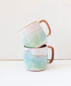 Add this gorgeous unique mug to your collection or gift it to a special friend. It's pretty enough to stare at and functional enough to use everyday! Wheel-thrown red clay mug with white and light gre Ceramic Mugs, Ceramic Art, Stoneware, Earthenware, Pottery Mugs, Ceramic Pottery, Tassen Design, Green Mugs, Cute Mugs