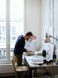 Leo Greenfield at his temporary workspace whilst in residence at the Paris atelier of Australian fashion designer Martin Grant.   Photo - Cl...