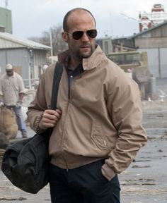 Jason Statham is wearing a Baracuta G9 (Harrington jacket, made in England since 1937) in Killer Elite