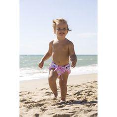 Bañador antiescapes para bebé con protección solar y etiqueta de aviso que cambia de color según el grado de exposición al sol (alto, medio o bajo)