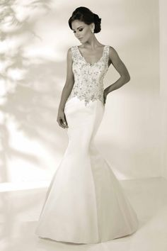 EMMA Style: 12847 Fabric: SATIN  THIS SOPHISTICATED FIL & FLARE FEATURES V NECKLINE AND ILLUSION BACK EMBELLISHED WITH LAVISH BEAEDED EMBORIDERY.