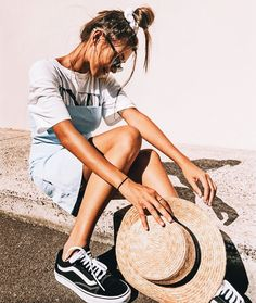 wear a denim dress over a graphic tee for a cute summer street style look