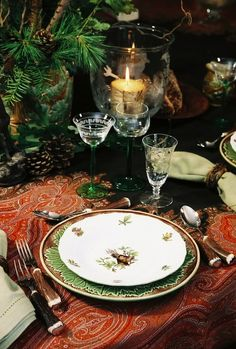 LOVE all the parts of this: the green stemware, the charger, the simple plate, the horn flatware...it's really inspired!
