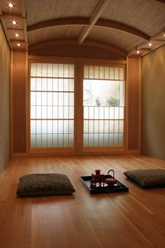 """Omoshiroi Wabi-sabi is the difference between what the Japanese call kirei, """"merely pretty,"""" and omoshiroi, the interestingness that makes something beautiful. The window breaking this meditation room's symmetry and offering a glimpse of a garden beyond gives the room omoshiroi."""