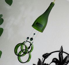 Glass Wind Chime, Recycled Green wine bottle wind chime,  Sun catcher, Yard art, Patio decor, House warming by LindasYardArt on Etsy