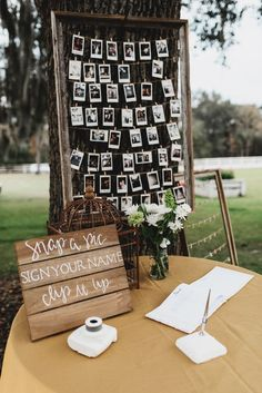 This would be cute instead of like a guestbook you could have everyone take pictures. Or along with a guestbook idk. You could have people sign their names on a tree slice too