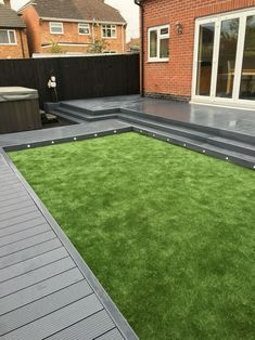 UPM Profi Composite Decking nicely paired together with an Astro Turf lawn.