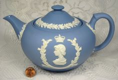 Wedgwood blue jasperware Queen Elizabeth II Coronation Teapot .. commemorating the 1953 coronation of Queen Elizabeth II, applied white profiles of the Queen and Price Philip on opposite sides and crowns, laurel leaf & berry wreaths, 1953, stoneware, UK