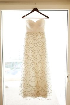 Such a gorgeous white and gold dress with scallop details.