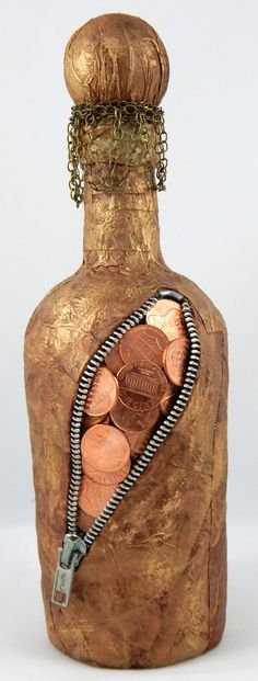 Steampunk/Industrial Altered Bottle. The bottles theme is rusty, bronze, brown found treasure with coins coming out from an open zipper. -15 inches height to include stopper -4 inches diameter at the widest point  Bottle is made with tissue paper, mulberry paper, real pennies, real zipper, bronze paint and chain. .  This piece makes a unique and funky home or office décor. Great gift for that special someone who is a fan of industrial, steampunk, goth or grunge aesthetic.