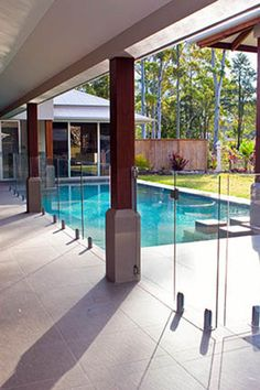 Frameless glass pool fencing with feet. I like the columns.