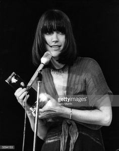 British pop singer Kiki Dee speaking to guests after receiving an award for Best Female Vocalist 1976 at the Capital Radio awards ceremony held at the Grosvenor House hotel, London.