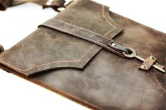 Brown Leather Messenger Bag - Distressed Leather Satchel - Skeleton Key Antique Hardware Steampunk Boho Bag  This rich oiled leather envelope style messenger bag features industrial strength leather-grade nylon stitching, silver hardware and an antique skeleton key as a closure. This messenger is roomy and perfect for carrying your essentials – whatever they may be. Each order has a different, unique key. The bag even features a hidden rear pocket, perfect for your phone! Over time the…