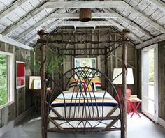 A bedroom under the eaves with willow bed and pendleton blankets ...cozy and cute!
