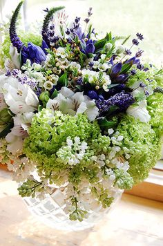 Like this compact but not roundy moundy centerpiece! -Michael George Flowers